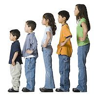 Profile of a children in profile with their hands on their hips Stock Photo - Premium Royalty-Freenull, Code: 640-01363785
