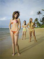 Portrait of three teenage girls standing on the beach Stock Photo - Premium Royalty-Freenull, Code: 640-01363808