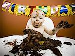 Baby eating birthday cake Stock Photo - Premium Royalty-Free, Artist: Push Pictures, Code: 640-01363832