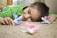 Close-up of a girl playing with toys Stock Photo - Premium Royalty-Freenull, Code: 640-01364349