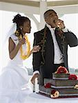Bride and groom eating their wedding cake Stock Photo - Premium Royalty-Freenull, Code: 640-01364564