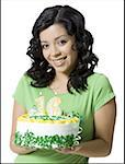 Close-up of a teenage girl holding a birthday cake Stock Photo - Premium Royalty-Free, Artist: Aurora Photos, Code: 640-01364999