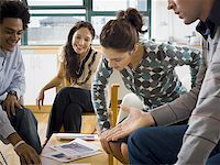 Four people discussing ad layouts Stock Photo - Premium Royalty-Freenull, Code: 640-01365063