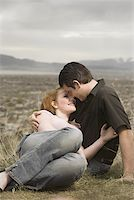 Young couple kissing in a meadow Stock Photo - Premium Royalty-Freenull, Code: 640-01365073