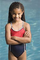 preteen bathing suit - Portrait of a girl standing at a swimming pool and smiling Stock Photo - Premium Royalty-Freenull, Code: 640-01366515