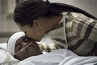 Close-up of a mother kissing her son Stock Photo - Premium Royalty-Freenull, Code: 640-01366626