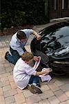 Father and Son Washing Car    Stock Photo - Premium Rights-Managed, Artist: Raoul Minsart, Code: 700-01374605