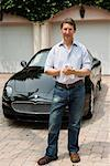 Portait of Man Standing in Front of Car    Stock Photo - Premium Rights-Managed, Artist: Raoul Minsart, Code: 700-01374608