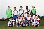 Portrait of Soccer Team With Gold Medals and Trophy    Stock Photo - Premium Royalty-Free, Artist: Masterfile, Code: 600-01374818