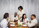 Woman serving dinner for friends Stock Photo - Premium Royalty-Free, Artist: Kablonk! RM, Code: 621-01375067