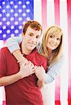Mother and son embracing in front of American flag Stock Photo - Premium Royalty-Free, Artist: Kevin Dodge, Code: 621-01375165