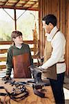 Father and son working on horseshoes Stock Photo - Premium Royalty-Free, Artist: George Shelley, Code: 621-01375180