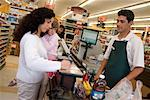 Woman at Grocery Store Cashier    Stock Photo - Premium Rights-Managed, Artist: Tim Mantoani, Code: 700-01380884