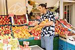 Young man selecting oranges outside greengrocers Stock Photo - Premium Royalty-Free, Artist: Carl Valiquet, Code: 613-01384605