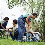 Man and woman with children (5- 10) working in garden Stock Photo - Premium Royalty-Free, Artist: Cultura RM, Code: 613-01385813