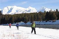 Three people cross country skiing Stock Photo - Premium Royalty-Freenull, Code: 613-01388449