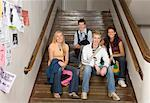 Four teenagers (16-18) sitting on stairway in school, portrait Stock Photo - Premium Royalty-Free, Artist: Marden Smith, Code: 613-01388547