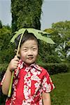 Young boy (6-8) holding plant leaf (Fatsia japonica) Stock Photo - Premium Royalty-Free, Artist: Carl Valiquet, Code: 613-01388691