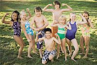 Group of children (7-12) flexing muscles, portrait Stock Photo - Premium Royalty-Freenull, Code: 613-01394645