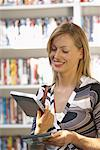 Woman at Video Store    Stock Photo - Premium Royalty-Free, Artist: Masterfile, Code: 600-01407156