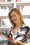 Woman at Video Store    Stock Photo - Premium Royalty-Free, Artist: Masterfile, Code: 600-01407157