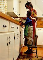 Mother and Son Cooking in the Kitchen Stock Photo - Premium Royalty-Freenull, Code: 618-01411399