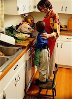Mother and Son Preparing a Thanksgiving Turkey Stock Photo - Premium Royalty-Freenull, Code: 618-01411401