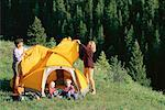 Mother and father pitching tent on mountain Stock Photo - Premium Royalty-Free, Artist: Derek Shapton, Code: 618-01419537
