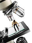 Miniature Man on Microscope
