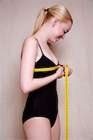 Woman measuring her chest Stock Photo - Premium Royalty-Freenull, Code: 644-01435997