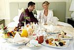 Mature couple having room service breakfast Stock Photo - Premium Royalty-Freenull, Code: 644-01436083