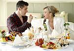 Mature couple having room service breakfast Stock Photo - Premium Royalty-Freenull, Code: 644-01436089