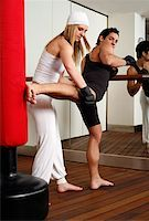 student fighting - Young man and woman practicing with a punching bag Stock Photo - Premium Royalty-Freenull, Code: 644-01436972