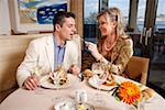 Mature couple dining in a restaurant Stock Photo - Premium Royalty-Freenull, Code: 644-01437312
