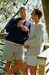 Couple Talking on a Deck Stock Photo - Premium Royalty-Freenull, Code: 618-01440840