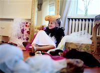 Girl Playing Dress-Up Stock Photo - Premium Royalty-Freenull, Code: 618-01440999