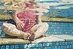 Girl sitting in pool waist down Stock Photo - Premium Royalty-Free, Artist: Raymond Forbes, Code: 640-01458635