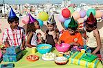 Children at Birthday Party by Edge of City