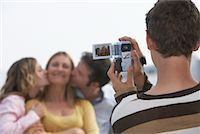 Boy Taking Video of Family    Stock Photo - Premium Rights-Managednull, Code: 700-01463771