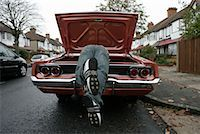 Man Looking through Trunk of American Car on English Street    Stock Photo - Premium Rights-Managednull, Code: 700-01463900