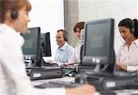 services - Business People Working on Computers with Headsets    Stock Photo - Premium Royalty-Freenull, Code: 600-01464