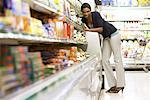Woman at Grocery Store    Stock Photo - Premium Rights-Managed, Artist: Noel Hendrickson, Code: 700-01464545