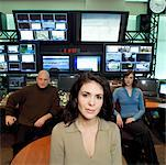 Three people seated in television control room Stock Photo - Premium Royalty-Free, Artist: Masterfile, Code: 613-01470095