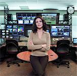 Professional woman standing in television studio control room Stock Photo - Premium Royalty-Free, Artist: Masterfile, Code: 613-01470096