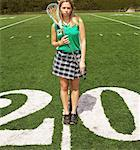 High school lacrosse player (16- 18) holding lacrosse stick on field Stock Photo - Premium Royalty-Free, Artist: Jean-Christophe Riou, Code: 613-01471141