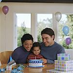 Baby boy (12-15 months) sitting with parents in front of birthday cake Stock Photo - Premium Royalty-Free, Artist: ableimages, Code: 613-01472503