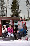 Four young adults with inner tubes and skis beside van in snow Stock Photo - Premium Royalty-Free, Artist: Scott Tysick, Code: 613-01474572