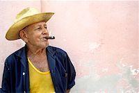 Cuba, Trinidad, senior man smoking cigar, looking away Stock Photo - Premium Royalty-Freenull, Code: 613-01478051