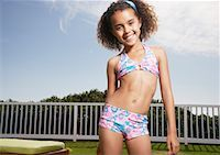preteen  smile  one  alone - Girl standing outdoors in swimsuit smiling Stock Photo - Premium Royalty-Freenull, Code: 635-01488983