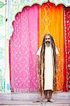 Portrait of a sadhu standing in front of a gate Stock Photo - Premium Royalty-Free, Artist: Robert Harding Images, Code: 630-01490695